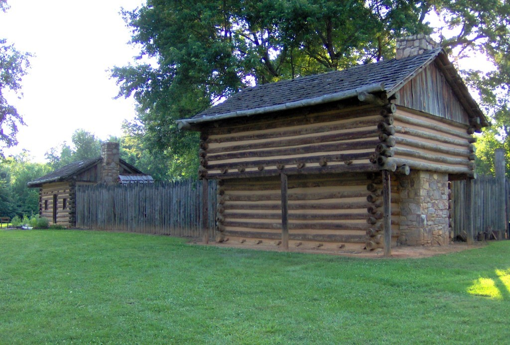 A replica of a blockhouse fort with stockade.